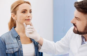 Woman Being Seen By A Dermatologist for Medical Conditions Atlanta GA