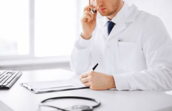 Doctor Studying Patient Chart Atlanta GA