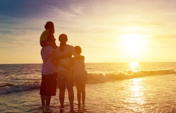 Family Standing on the Beach at Sunset Atlanta GA